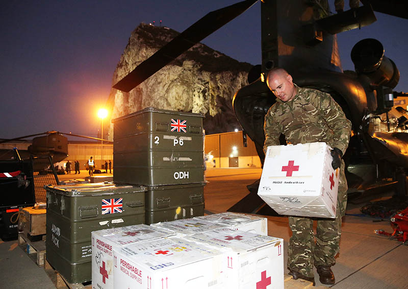 RAF personnel unload aid for Hurricane Irma victims