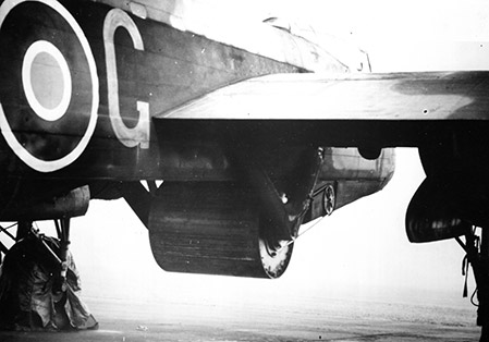 Upkeep bomb underneath a Lancaster bomber